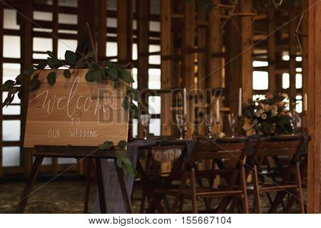 Wedding banquet in a wooden barn. Vintage Style.