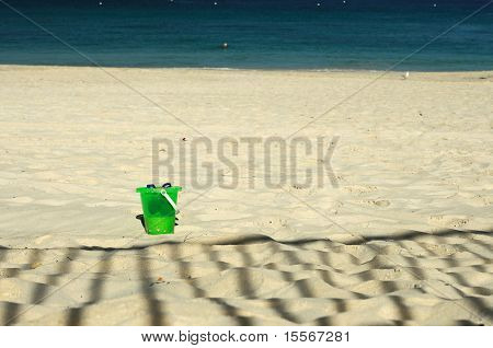 baby bucket in the sand on the beach