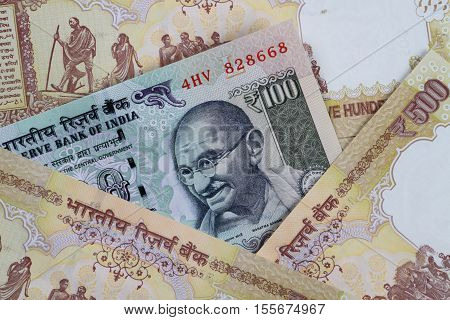 Rupee 100 Note in between demonetized 500 INR Notes