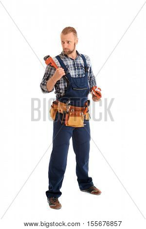 Handsome plumber with pipe wrench and gloves isolated on white