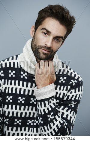 Handsome man in fashion knitwear studio portrait