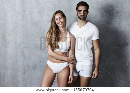 Beautiful people in white underwear studio shot
