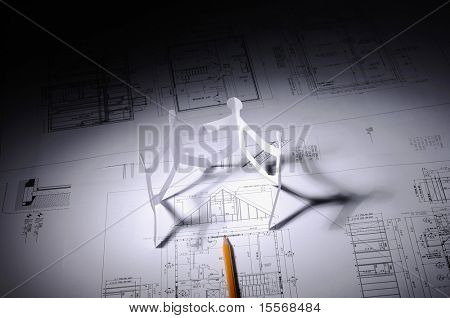 drawings of building and small paper manikins