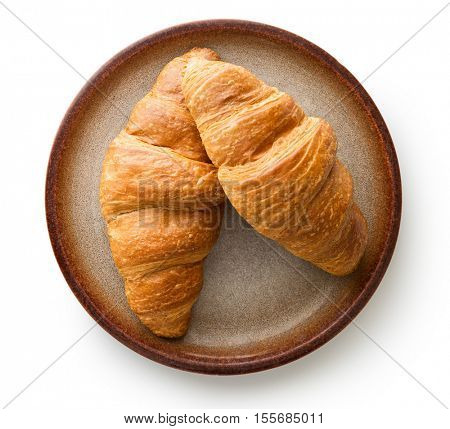 Tasty buttery croissants on plate. Isolated on white background.