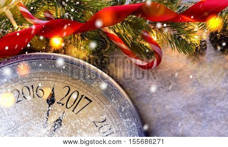 Countdown to midnight. Retro style clock counting last moments before Christmas or New Year 2017 next to decorated fir tree. View from above.