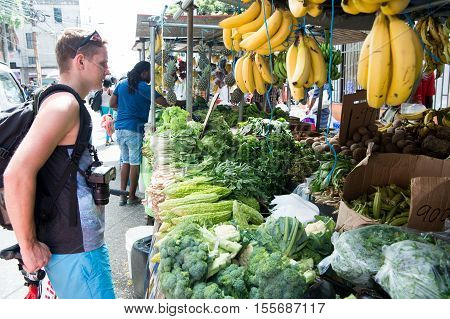 Handsome Man Buys Vegetables