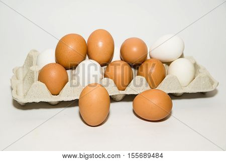 A lot of Chicken eggs is in a carton for sale.