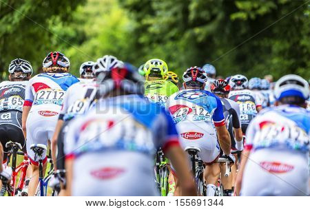 Bouille-MenardFrance - July 4 2016: Rear image of the peloton riding during the stage 3 of Tour de France in Bouille-Menard on July 4 2016.