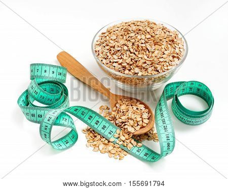 Diet! Lose weight! Oats in bowl with tape measure on white background. Healthy food Concept. High resolution product