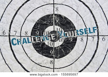 Text Challenge Yourself written in the center of a target