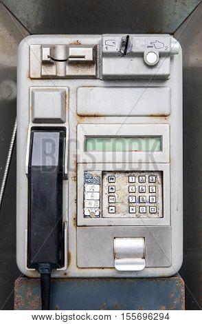 Rusty phone box in Puerto de la Crus in Tenerife (Spain)