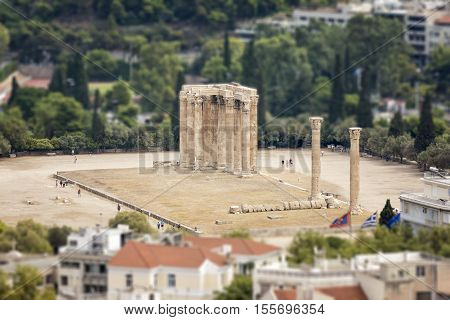 ATHENS, GREECE, SEPTEMBER 6,2016: Tilt shift photo of The Temple of Zeus, a colossal ruined temple in the centre of the Greek capital city Athens, famous tourist attraction.