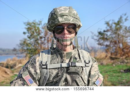 Portrait of soldier at military firing range
