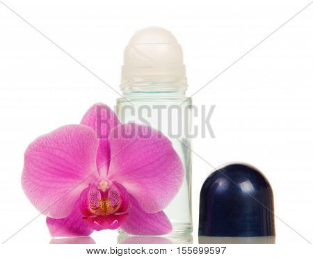 Compact roll deodorant and orchid flower isolated on white background.