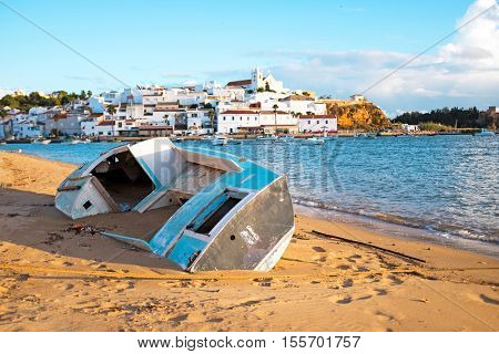 Old fisherman's boat at the beach near Ferragudo in the Algarve Portugal