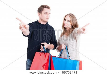 Couple Holding Shopping Bags Making No Gesture