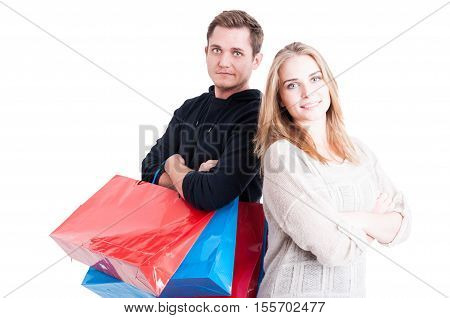 Couple Holding Up Shopping Bags Standing With Arms Crossed