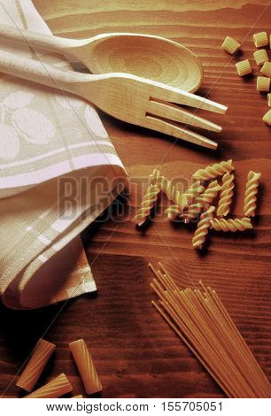various types of pasta on a wooden table