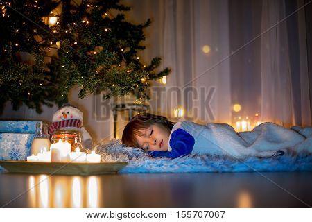 Beautiful Little Child, Boy, Lying Down On The Floor,sleeping Under The Christmas Tree