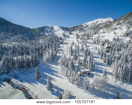 Aerial View Of People Skiing In A Beautiful Snowy Soriska Planina Ski Resort, Slovenia
