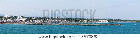 Panorama of Laccadive Sea and Kanyakumari town on the background of mountains at the southernmost point of India formerly known as Cape Comorin in the state of Tamil Nadu in India.