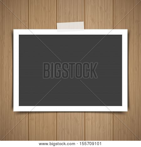 Photo frame stick on vintage wooden texture. Vector illustration