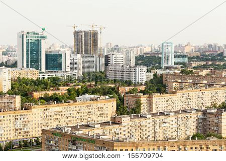 Moscow Russia - 22 June 2016: Moscow panoramic view from above - avenues residential area Sberbank of Russia office center building construction cranes and new buildings. High angle view
