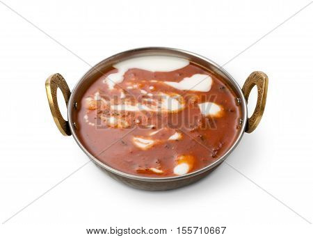 Vegan and vegetarian dish, spicy creamy tomato soup bowl with white yoghurt sauce. Indian cuisine, masala hot meal isolated on white background. Eastern local cuisine restaurant food