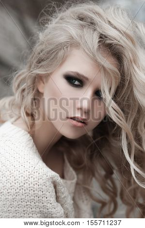 Close Up Of Beautiful Young  Blonde Woman With Blue Eyes In White Pullover. ..winter, Spring, Outdoo