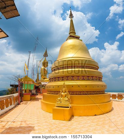 KRABI THAILAND - APRIL 10: Golden Chedi on the top of Tiger Cave Temple on April 10 2016 in Krabi Thailand