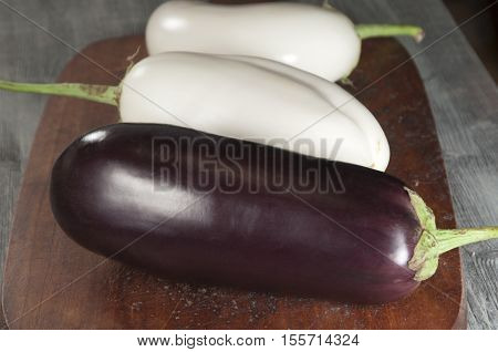 Egg fruits white and dark on a timber board