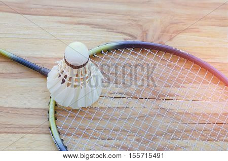 badminton ball shuttlecock with racket on court floor black and white tone