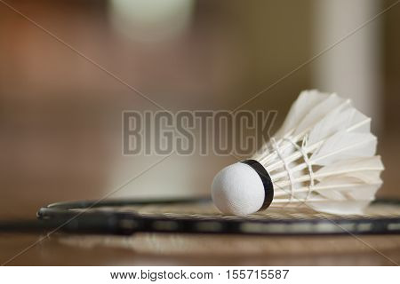 badminton ball shuttlecock with racket on court floor vintage