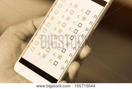 exams answer quiz on smart phone with multiple-choice questions e-learning online : education concept gray color