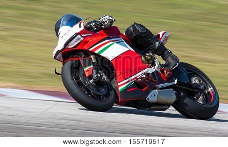 Panning shot of racing motorcycle on a bend