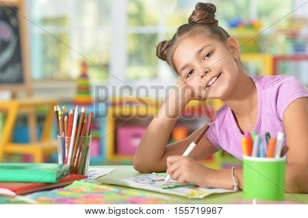 Portrait of a student girl with books and homwork