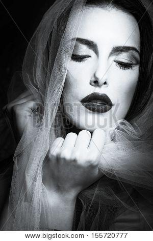 young woman beauty portrait with veil bw studio shot