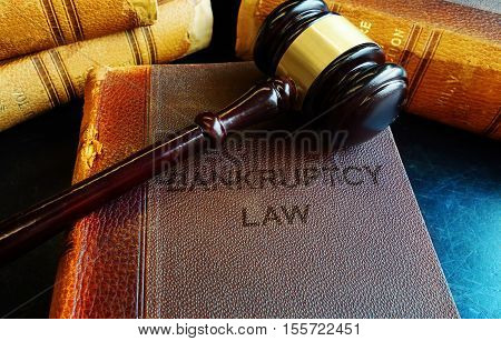 Bankruptcy Law books with a court gavel
