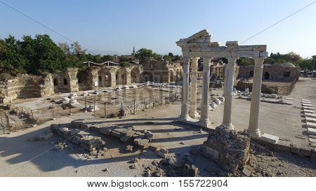 Ruins of the ancient city of Side and the Amphitheatre photo with the bird flight.