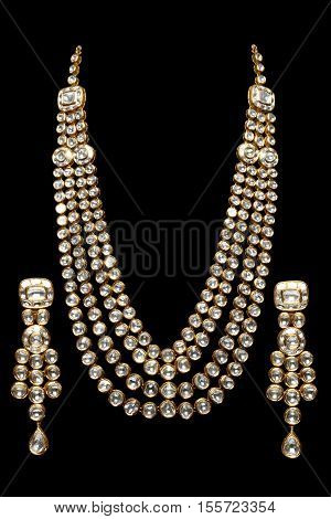 Close up of Diamond Necklace on black background with Diamond Earring.