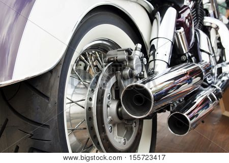 Purple motorcycle. Close-up wheel of motobike. Traveling concept.