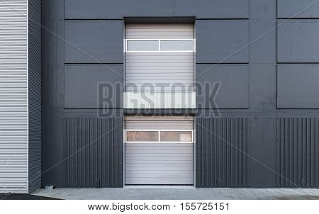 Two Level Closed Gates In Gray Metal Wall