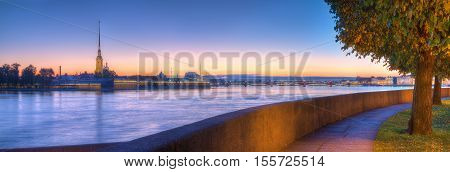 Panoramic view of alley on Spit of Vasilyevsky Island Peter and Paul Fortress and Neva River at dawn Saint Petersburg Russia