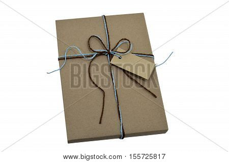 Gift wrap brown paper tie knot with natural string and note isolated on white with clipping path.