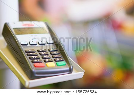 Credit card payment. Payment terminal with credit card in supermarket
