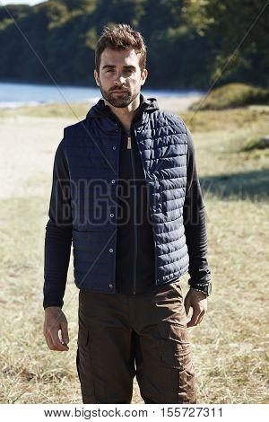 Handsome hiker in body warmer portrait nature