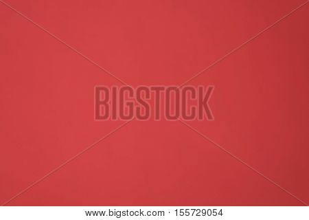Background or texture of crimson paper.In Closeup.