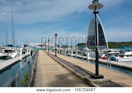 PHUKET THAILAND - JUNE 272016 : Walkway bridge to harbor in Ao Po Grand marina luxury yachts and sailboats at AO PO GRAND MARINA 272016 at Ao Po Paklok Phuket Thailand