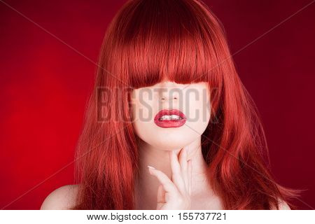 Woman With Red Wig On Red Background