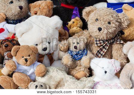 assortment of old teddies at flea market